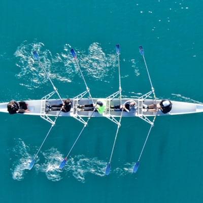 aerial shot of rowers rowing