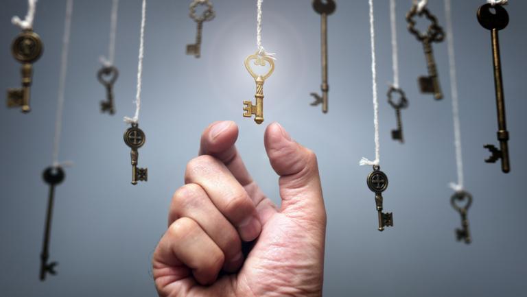 hand reaching up to hanging keys