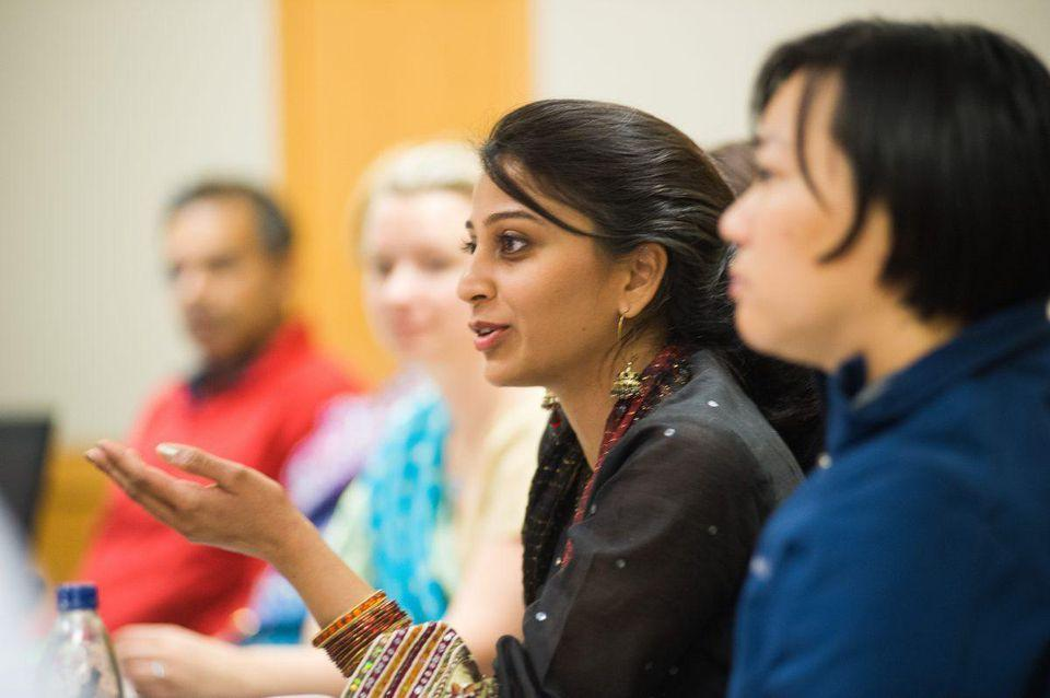 female indian participant talking in a program