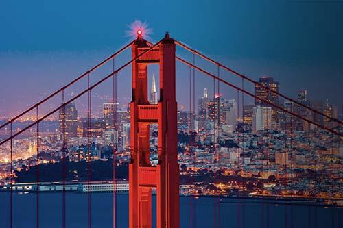 Golden Gate bridge and SF skyline at dusk