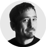 black and white headshot of Tim Gray