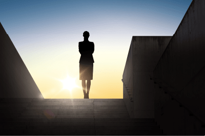 silhouette of a women standing on top of a staircase